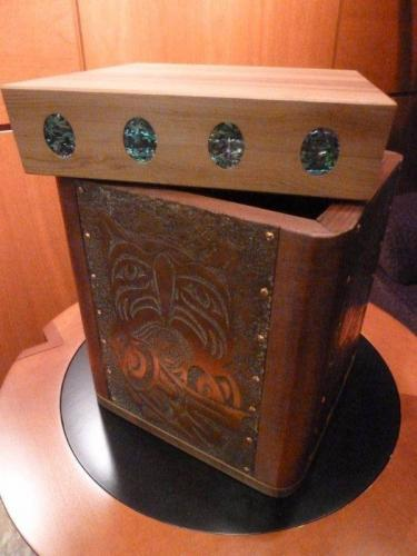 Box by Shain Jackson donated by Spirit Works to the First Nations Law Students Scholarship Fund.  A Large painted bentwood box inlaid with abalone and adorned with copper chasing work.